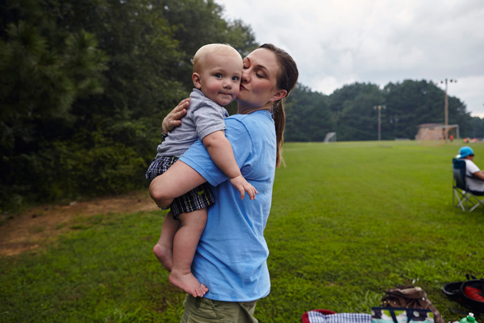 Casey Shehi hugging her infant son James.