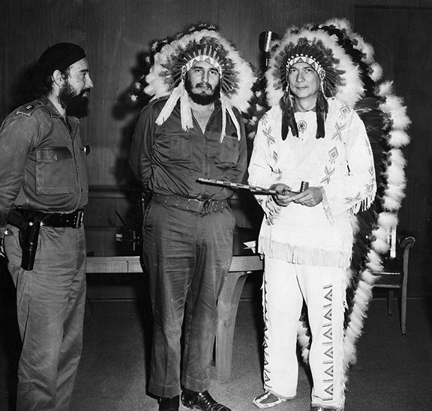 Cuban Premier Fidel Castro, center, and Oklahoma Creek Indian missionary, W.A. Reiford, wear war bonnets, July 17, 1959, when Reiford came to Havana to open an orphanage. Reiford holds a peace pipe.
