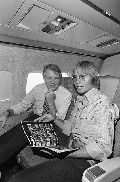 John denver aboard carter s plane en route to los angeles 1976 ap