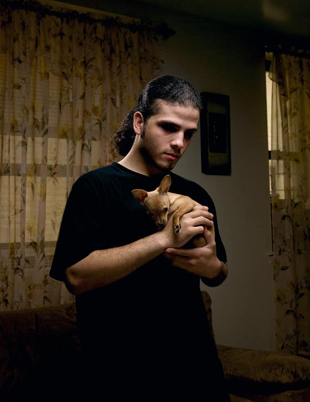 man holding small dog