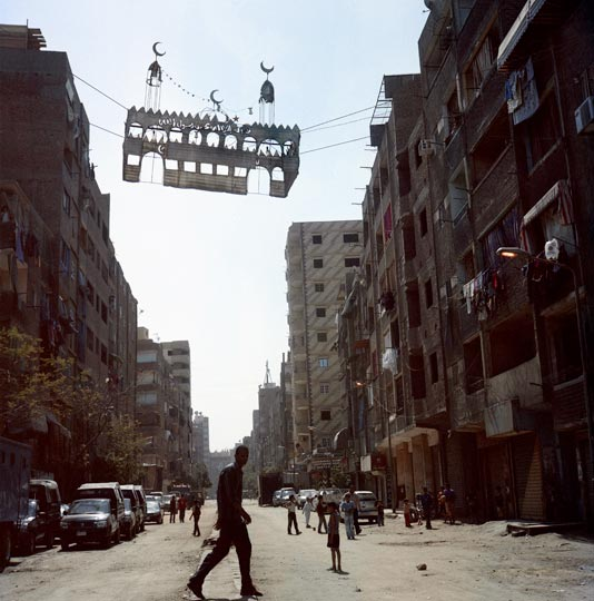 Following sectarian violence in May 2011, Imbaba's Luxor street is cordoned off by the army, limiting access for local residents.