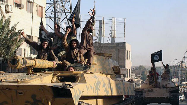 ISIS fighters during a parade in Raqqa, Syria Raqqa Media Center/AP