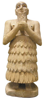 """Alabaster statue of a Mari man, 2400 BC. The statue is on the """"Red List"""" of artifacts most at risk of being smuggled out of Syria. National Museum of Damascus/Sophie Cluzan/ICOM"""