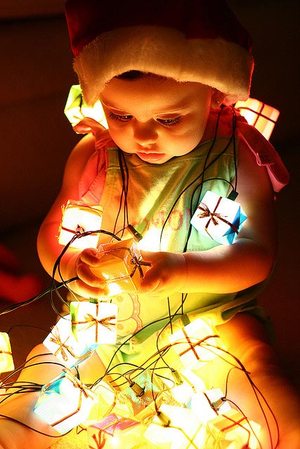 baby in christmas lights