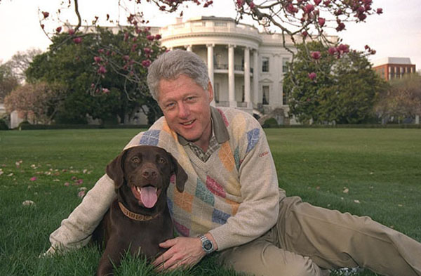 President Clinton with his dog Buddy in front of the White House.