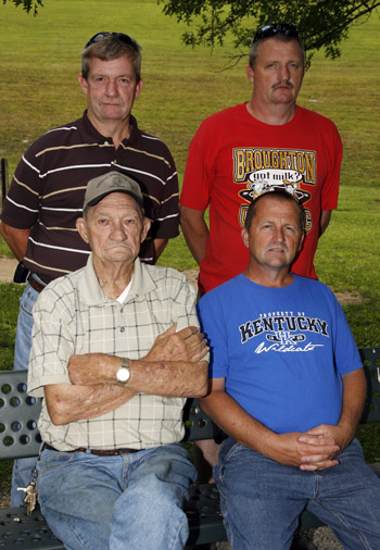 Retired Kentucky coal miner Ray Marcum (bottom left) and his sons (clockwise from top left) Thomas,  James, and Donald. All four have a form of black lung. Photo by Center for Public Integrity