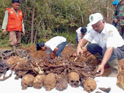 This mass grave was uncovered in central Aceh, the province where a bloody civil war raged for years. A decade-old case alleges Indonesian government soldiers hired by Exxon Mobil tortured, killed, and assaulted villagers in Aceh. Jacqueline Koch, epa/Corbis