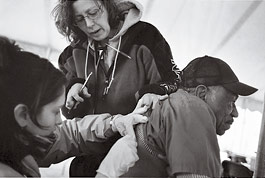 health care workers assist a patient