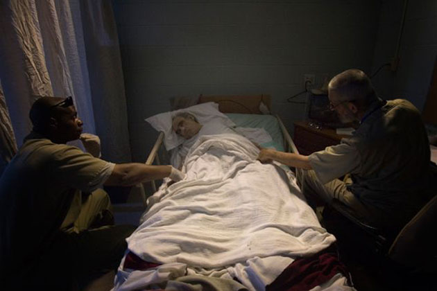 An elderly prisoner passes his final hours in the hospice unit.