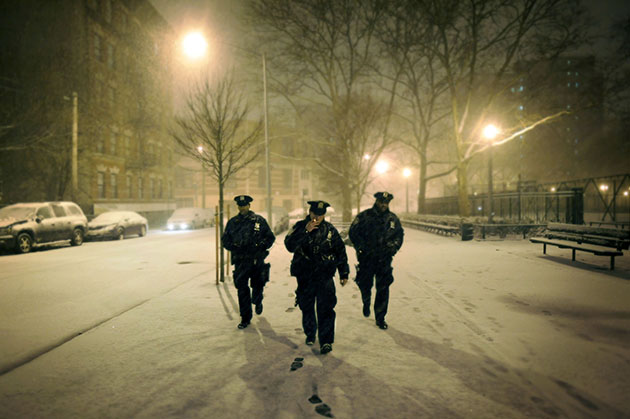 Officers walk through a snowstorm in the Mott Haven neighborhood of the Bronx.