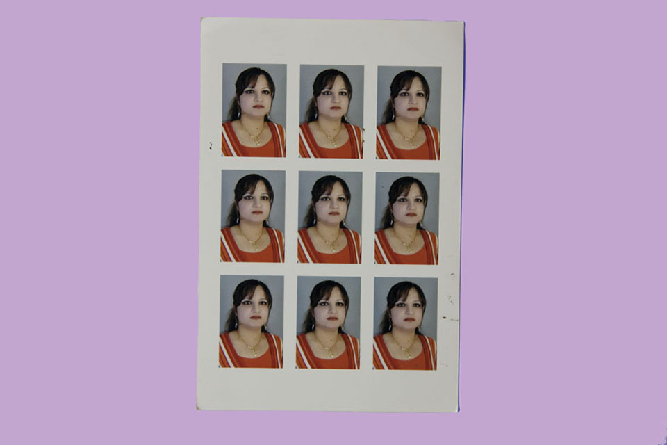 An unknown woman's headshot sheet, picked up at a Kurdistan photo studio.