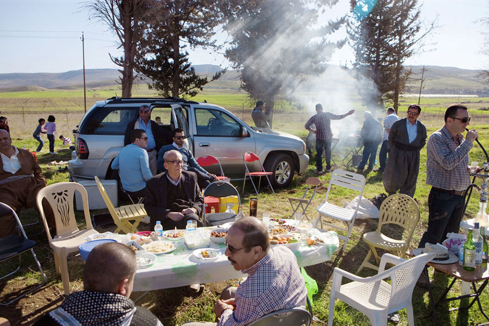 The Ahmed family from Sulaimani enjoys a picnic on the day after Newroz, the Kurdish new year. Many of the family's members emigrated to Canada, the United States, and Germany for safety and opportunity 20 years ago; today, many emigrants are returning to their homeland to open businesses, get in touch with long lost family, or just finally come home.