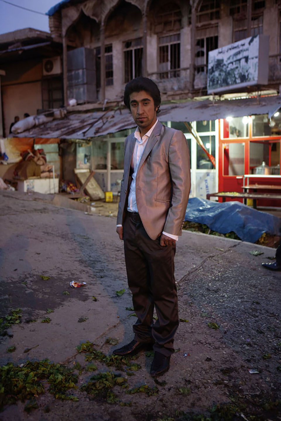 In the central Erbil market as the day ends, a man stands all dressed up with nowhere to go. Although great gains have been made in the new, semi-independent Kurdistan since 2003, there is still a long way to go in developing the infrastructure, both economic and social, to secure the autonomy and success of the Kurdish state.