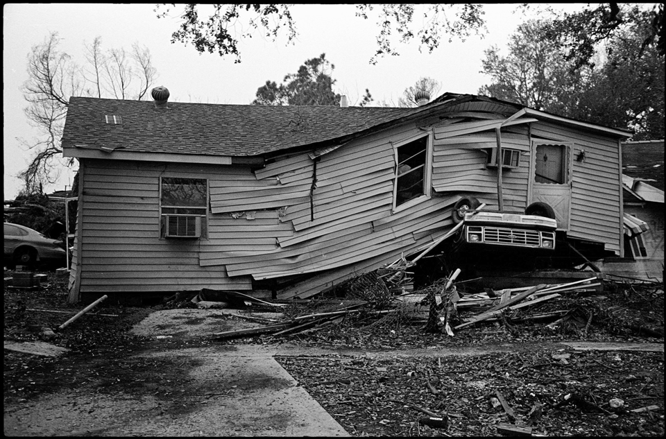 lower 9th ward after hurricane katrina - house on top of car