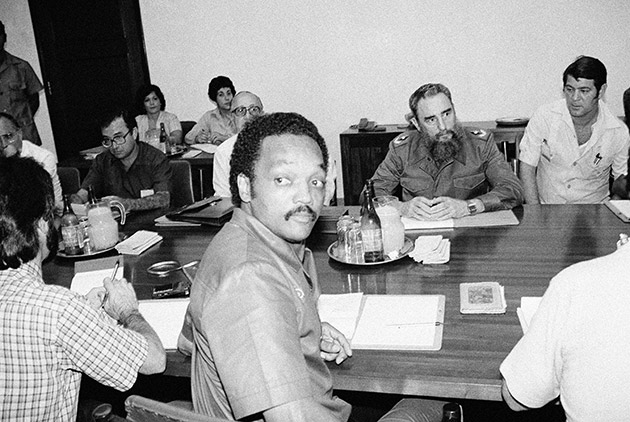 "Democratic presidential candidate Rev. Jesse Jackson sat down with Cuban President Fidel Castro and other high Cuban government official at the National Palace in Havana Tuesday, June 26, 1984, to discuss ""peace options"" in the area of Cuban-U.S. relations and Central America."