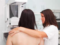 Nurse with woman having a mammogram