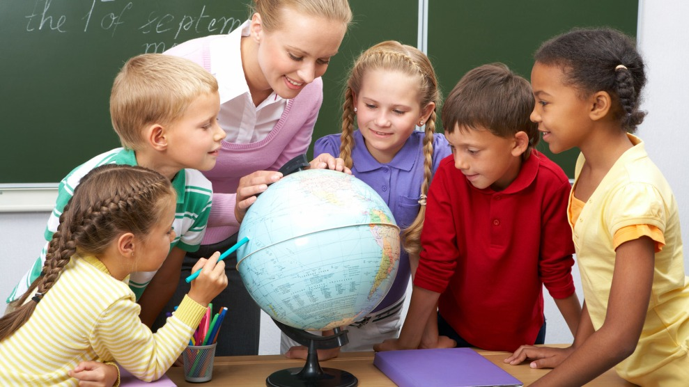 Students looking at a globe