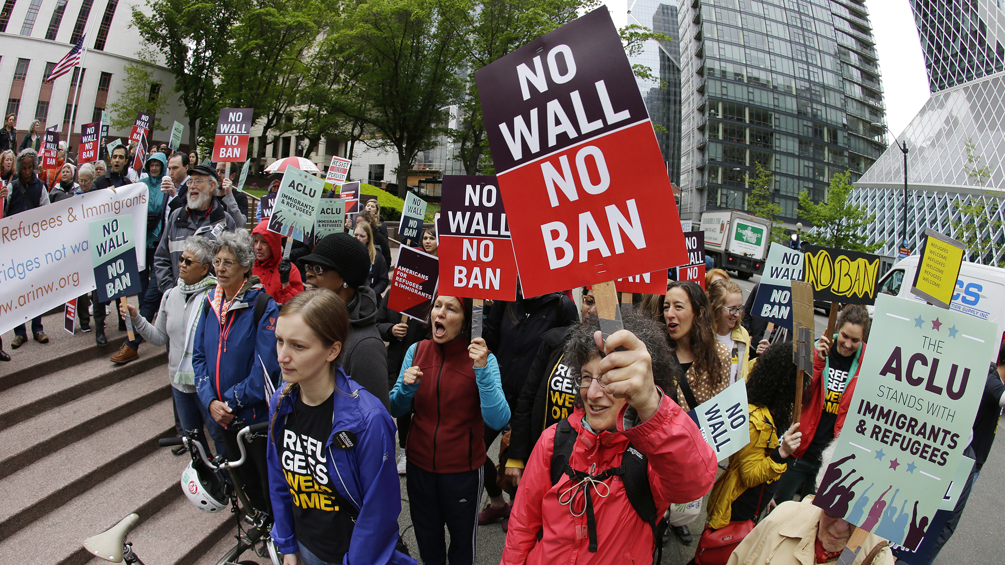 Protesters demonstrate against President Donald Trump's revised travel ban outside a federal courthouse in Seattle in May 2017 Ted S. Warren  AP File