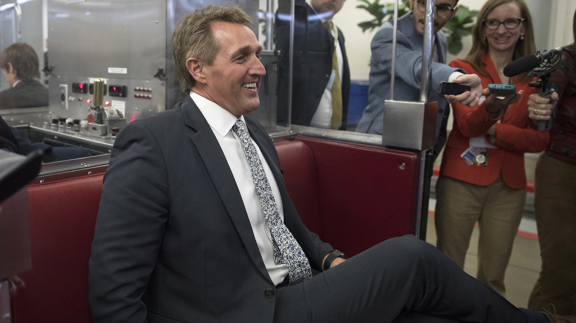 Sen. Jeff Flake boards the subway at the Capitol