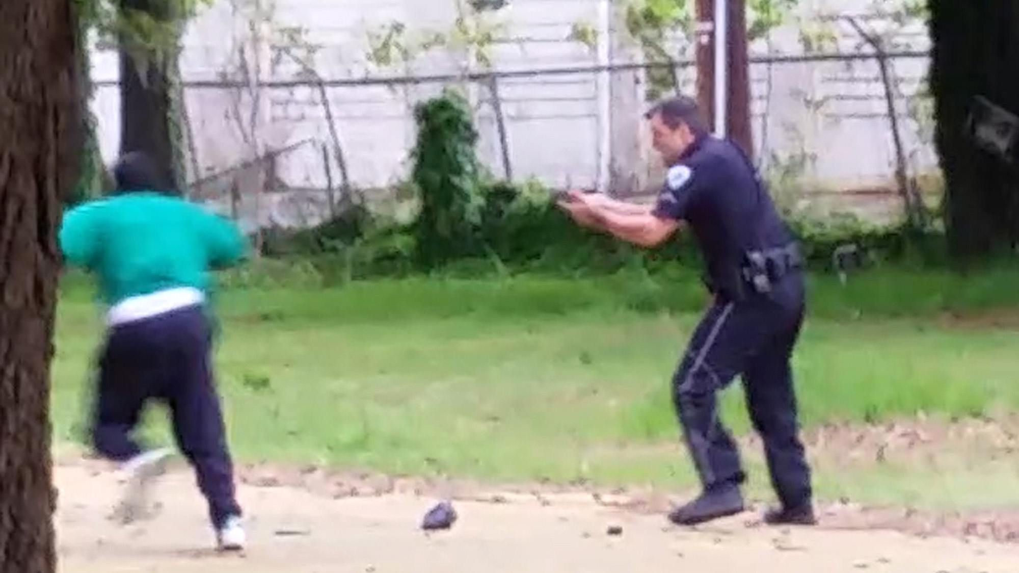 In this video frame Slager wields his Taser. Feidin Santana