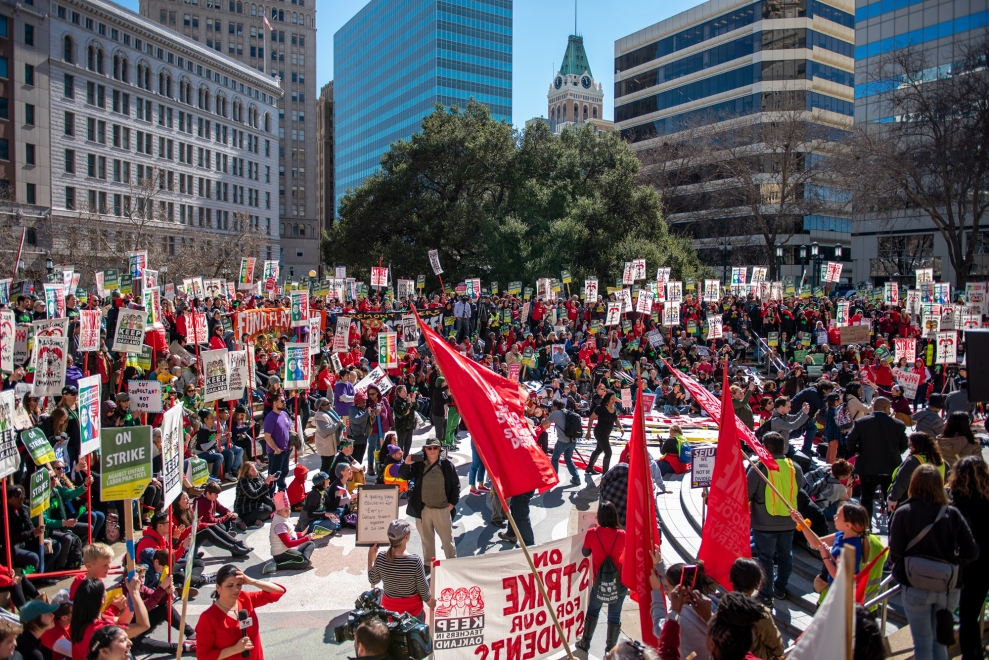 Hundreds of teachers, students, and supporters rally in downtown Oakland, Calif., on the first day of a district-wide teacher strike.