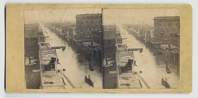 Stereoscope photo of J Street in Sacramento during the 1862 flood.