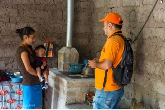 A project supervisor is seen here conducting a follow-up visit and speaking with local residents who have received a clean cookstove as a result of the initiative in Honduras.