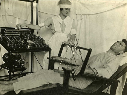 A man sits in a Bergonic chair for electroshock treatment. Wikipedia