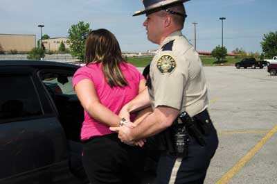 A police officer handcuffing a woman