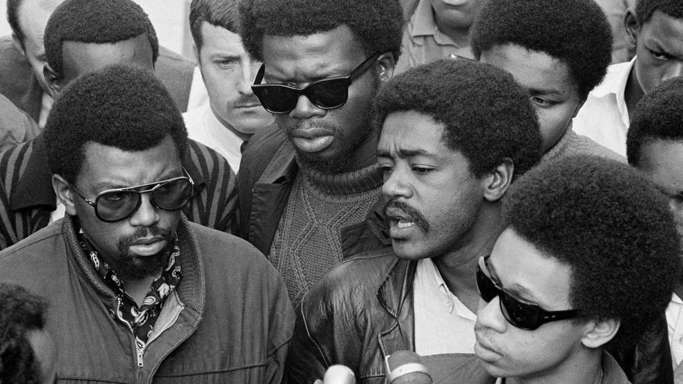 An image of Ben Stewart, George Murray, and Bobby Seale at a press conference