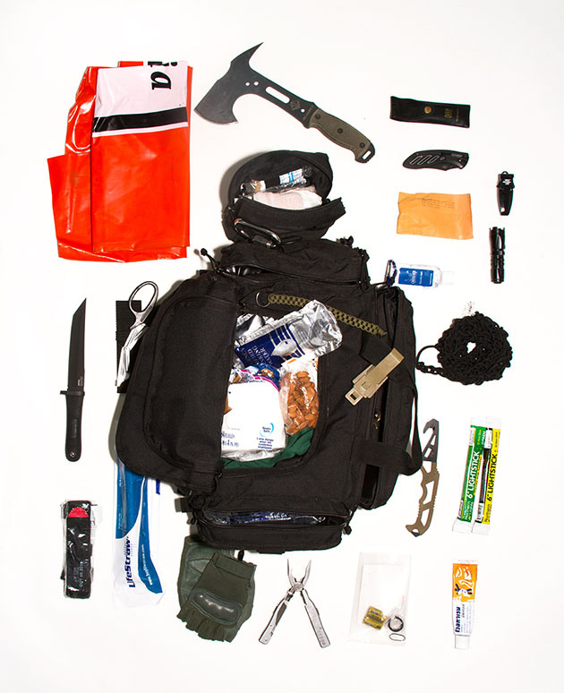 "Curtis lives in Earthquake country and his bag contains a Lifestraw, which is a personal water filtering system, lightsticks, an orange plastic recycling bag that could be used for shelter, as a raincoat, or as a ""flag"" to notify helicopters of your presence."