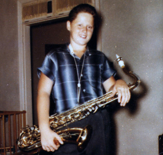 Bill Blythe with a saxophone, celebrating his 12th birthday at his home in Hot Springs, Arkansas, in 1958.