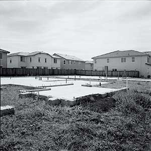 Empty houses and unfinished slabs fill a subdivision in Lathrop, California.