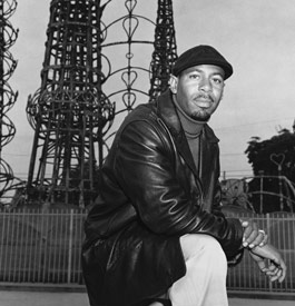 Aqeela Sherrills, gang member and street worker, in front of the Watts Towers