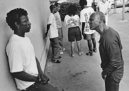 In South Central L.A., a gang-intervention counselor talks with a youth named Kemo, who was later killed.