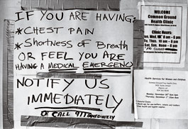 hand-written sign on the clinic door: 'If you are having chest pain, shortness of breath, or feel you are having a medical emergency, notify us immediately or call 911 immediately.'