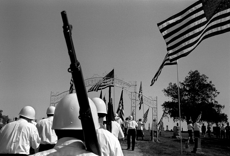 Members of the American Legion march during a Memorial Day service in Riverside, Iowa (2003)