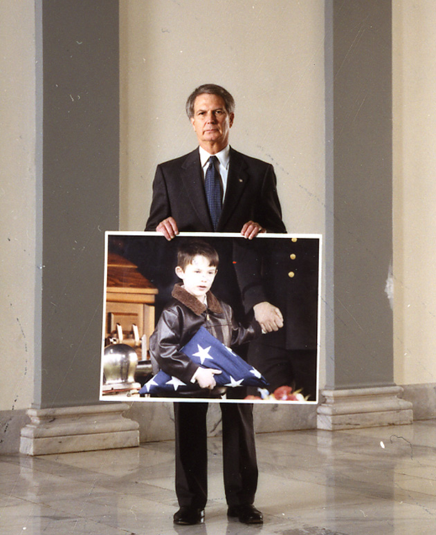 In his office, Jones keeps a portrait of six-year-old Tyler Jones, whose father was killed in Iraq in 2003.